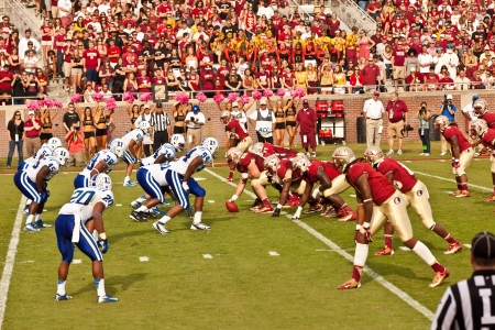 homecoming: Tallahassee, Florida - October 27, 2012:  FSU offense line sets for the call from Quarterback, EJ Manuel, as they face Duke University during Homecoming weekend at Doak Campbell Stadium in Tallahassee, Florida. Editorial