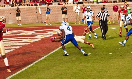 touchdown: Tallahassee, Florida - October 27, 2012:  Florida State player makes a touchdown, beating Duke University at Doak Campbell Stadium in Tallahassee, Florida.