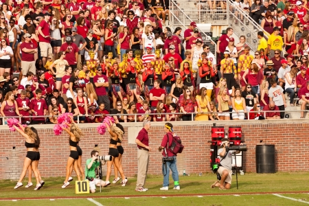 Tallahassee, Florida - October 27, 2012:  FSU students cheering for the Seminole football team during Homecoming weekend, a FSU vs. Duke University game at Doak Campbell Stadium in Tallahassee, Florida.
