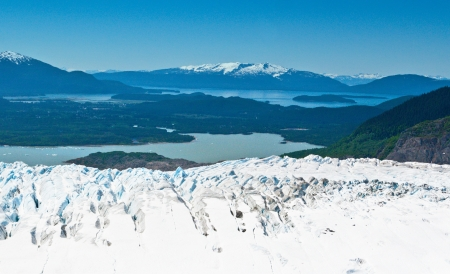 From the top of Mendenhall Glacier, the small town of Juneau, Alaska photo