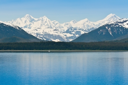 Beautiful snow capped Alaskan  mountain range along the Inside Passage Stock Photo