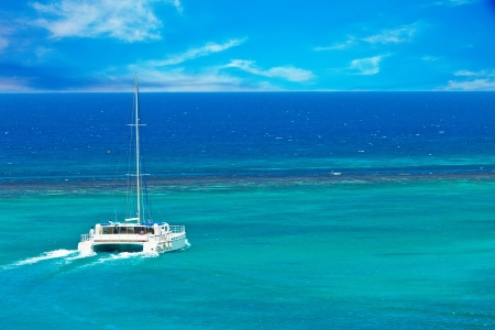 Large catamarn sailing out on the Caribbean
