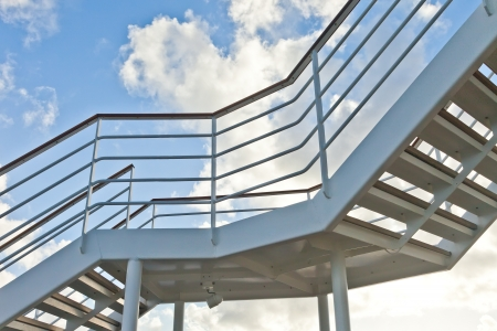 metal handrail: Metal staircase with blue sky
