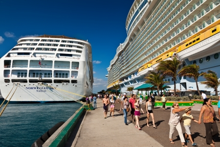 disembark: Nassau, Bahamas - Jan. 13, 2013:  Cruise ship passengers disembark from ship in Nassau, the capital city of the Bahamas.  Tourism accounts for nearly sixty percent of the islands income. Editorial
