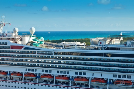 Looking over cruise ship to view sailboat on the Atlantic Ocean