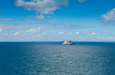 Large boulder rock sits in the middle of the Caribbean Sea