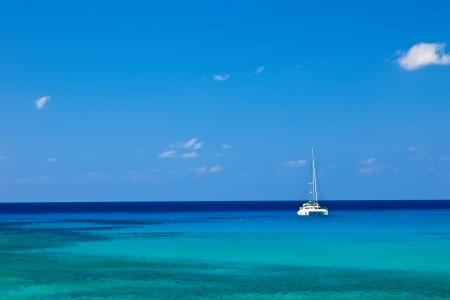 Large catamaran sailing in Grand Cayman, Cayman Islands