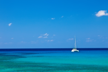 Large catamaran sailing in Grand Cayman, Cayman Islands