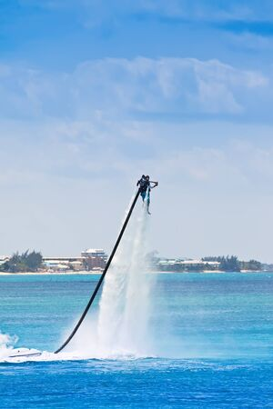 Man uses water jet pack on the Caribbean Sea