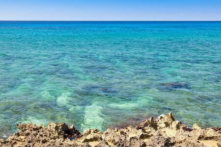 Turquoise blue Caribbean Sea with coral reef coastline