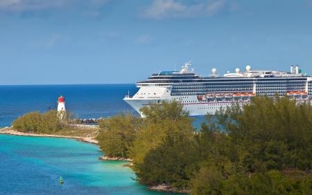 enters: Luxury cruise ship enters the port of Nassau, Bahamas Stock Photo