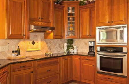 kitchen furniture: Traditional designed kitchen with wooden cabinets and granite