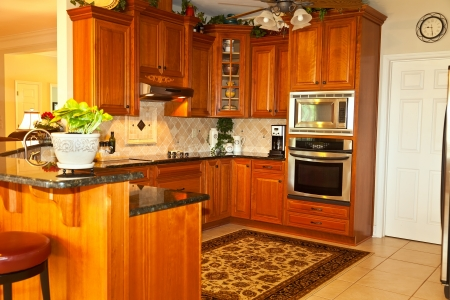 Traditionally designed kitchen with granite and travertine tile photo