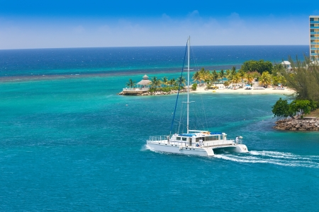 Large luxury catamaran sailing in the harbor of Ocho Rios, Jamaica