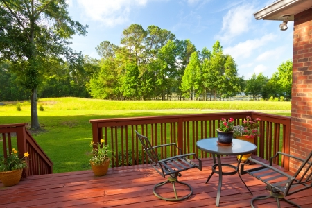 backyards: Residential backyard deck overlooking lawn and lake Stock Photo