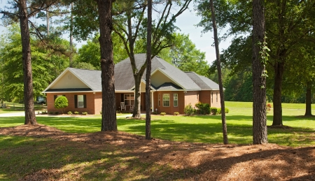 rural community: Brick colonial home in rural Florida in the countryside Stock Photo