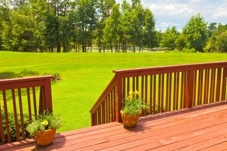 Large residential wooden backyard deck