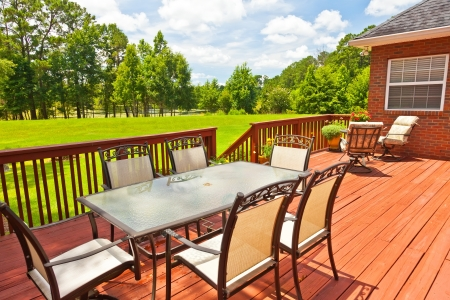Large residential wooden backyard deck with furniture Stockfoto