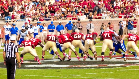 tallahassee: Tallahassee, FL - Oct. 27, 2012:  Florida State Seminole QB EJ Manuel (#3) drops back behind his offensive line in a college football game against Duke University on Oct. 27, 2012 in Tallahassee, Florida.