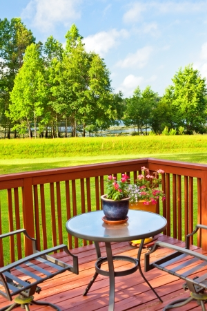 Wooden deck overlooking backyard lawn and lake Stock Photo - 21974157