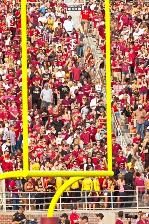 Tallahassee: Tallahassee, FL - Oct. 27, 2012:  College students cheering in the stands at a Florida State University football game in Tallahassee, Florida on October 27, 2012.