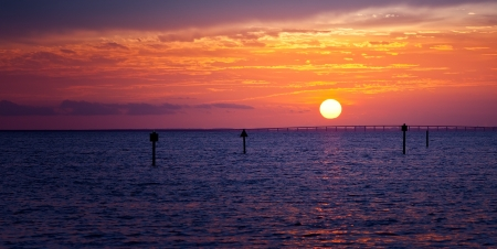 gulf of mexico: Beautiful golden sunset over the horizon in Destin, Florida Stock Photo