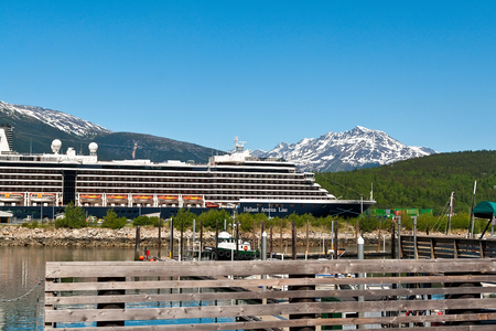 Skagway, Alaska - June 2, 2009:  Holland America's ship, the Zuiderdam, in the port of Skagway.  In 1971, Holland America changed from passenger transportation to pleasure cruising with one of it's destinations being Alaska.