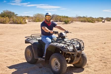 quad: All Terrain Vehicle rider in Cabo San Lucas, Mexico