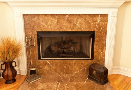 fireplace: Residential gas fireplace with marble tile