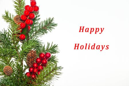 happy holidays text: Evergreen and red berry border with Happy Holidays text