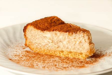 cinammon: Slice of cream cheesecake with a cinammon topping Stock Photo
