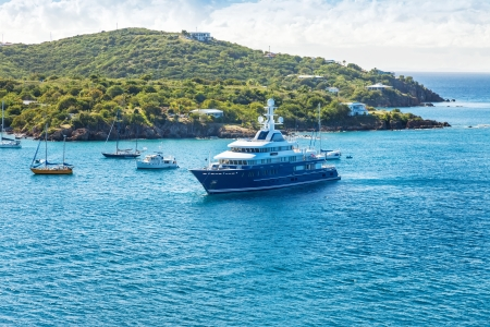 Various yachts and motorboats make their way into the St. Thomas harbor