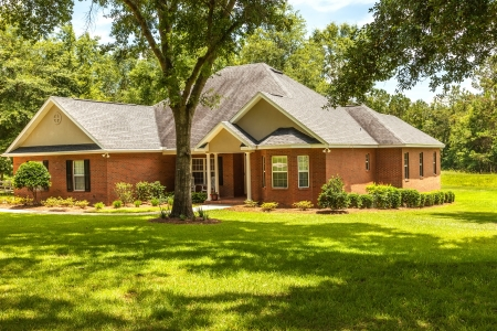 front house: Traditional style house with plenty of acres in rural Florida