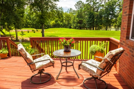 deck: Backyard deck overlooking lake outside residential structure Stock Photo