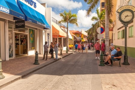 Philipsburg, St. Maarten - Jan. 19, 2011:  Tourists shop along the busiest street in Philispburg, Front Street, for local souveniers and bargains. Most visitors are cruise passengers and only in port for the day. Redactioneel