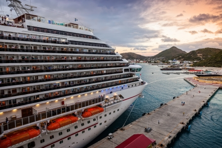 caribbean cruise: Philipsburg, St. Maarten - Jan. 16, 2013: Cruise ship anchored in the popular tropical island of St. Maarten at sunset.  The Dr. A.C. Wathey Cruise Pier was recently dredged to accomodate larger cruise ships.
