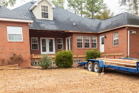 damaged roof: Wooden deck reconstruction at residential house Editorial