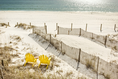 adirondack chair: Pair of adirondack chairs set to watch the Gulf of Mexico in Panama City Beach, USA