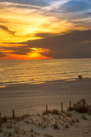 Sunset over the Gulf of Mexico in Panama City Beach , USA photo