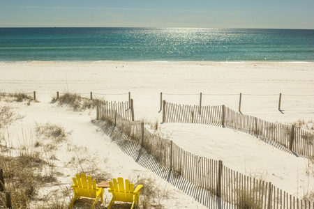 panama city beach: Pair of adirondack chairs set to watch the Gulf of Mexico in Panama City Beach, USA