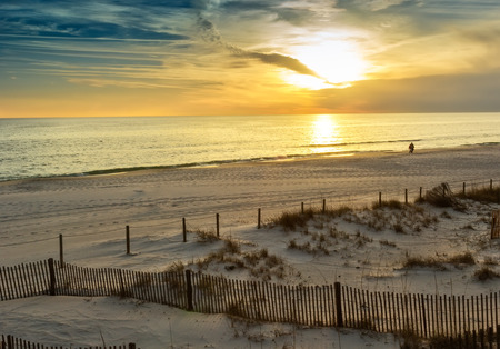 Sunset over the Gulf of Mexico in Panama City Beach in, USA photo
