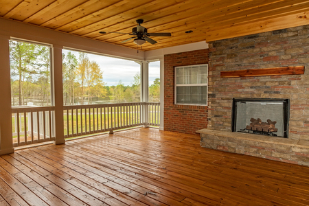 New backyard deck with fireplace overlooking lake