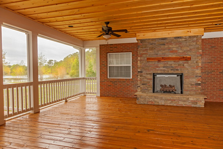 outdoor fireplace: New backyard deck with fireplace overlooking lake