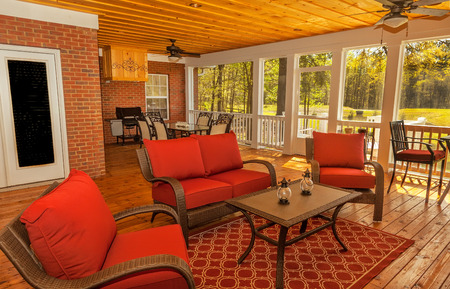 gas fireplace: New backyard deck with fireplace overlooking lake with furniture Editorial