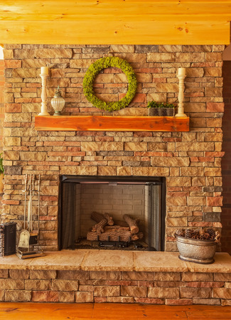 gas fireplace: Large stone gas fireplace on interior deck