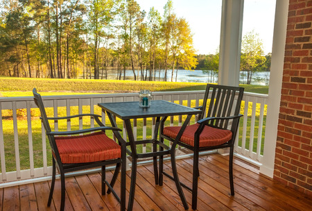 garden furniture: Screened patio with furniture overlooking lake