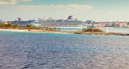 Nassau, Bahamas - Jan. 13, 2013:  The Bahamas is a popular cruise destination with multiple cruise ships docked in the port, bringing thousands of tourists to the island on a daily basis. Редакционное