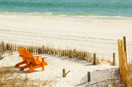 Pair of Adirondack chairs on Panama City Beach in Panama City, Florida