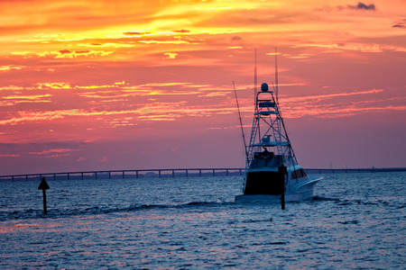 destin: Large fishing boat going out for sunset cruise in Destin, Florida Stock Photo