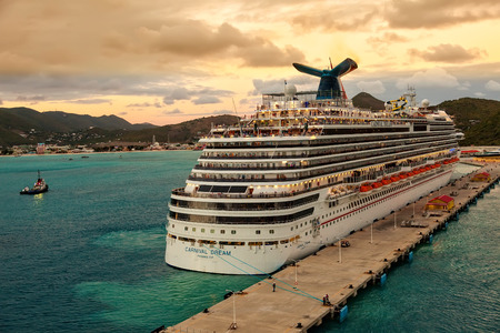 caribbean climate: Philipsburg, St. Maarten - Jan. 16, 2013:  Carnivals Dream ship gets ready for departure from St. Maarten at sunset.  The ship is one of Carnivals largest ships, one of three in the line of Dream-classes. Editorial